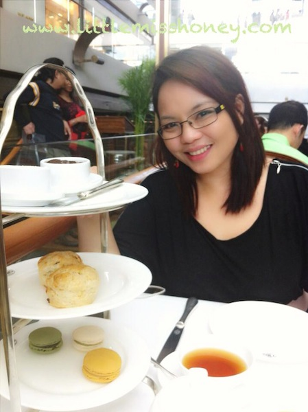 My sister in TWG with scones and macarons